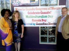 Kenny Daodu of NICCOM with Heritage Minister Shelly Glover and MLA Kelvin Goertzen (PC, Steinbach) at the 2014 NICCOM Multiculturalism Day event sponsored by Canadian Heritage.