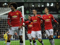 Manchester United's Marouane Fellaini, left, celebrates after scoring against West Brom during the English Premier League soccer match between West Bromwich Albion and Manchester United at the Hawthorns, Birmingham, England, Monday, Oct. 20, 2014. (AP Photo/Rui Vieira)