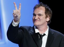 """FILE - In this Feb. 28, 2014 file photo, U.S director Quentin Tarantino shows a v-sign during the 39th Cesar Film Awards at Theatre du Chatelet in Paris, France. Colorado has approved a $5 million incentive package to lure production of the upcoming Tarantino film """"The Hateful Eight."""" The state Economic Development Commission approved the package Friday, Sept. 26, 2014. (AP Photo/Jacques Brinon, file)"""