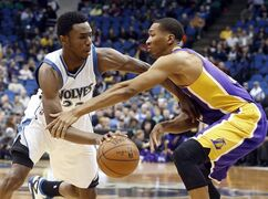 Minnesota Timberwolves' Andrew Wiggins drives as Los Angeles Lakers' Wesley Johnson defends during the first quarter of an NBA basketball game, Wednesday, March 25, 2015, in Minneapolis. (AP Photo/Jim Mone)