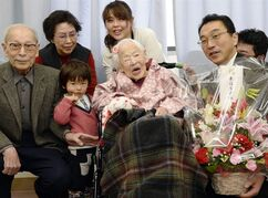 FILE - In this March 4, 2015 file photo, Japan's Misao Okawa, then 116, who is recognized as the world's oldest living person by Guinness World Records is celebrated by Ward Mayor Takehiro Ogura at a nursing home in Osaka, western Japan ahead of her birthday on March 5. Okawa died Wednesday, April 1, 2015, a few weeks after celebrating her 117th birthday. (AP Photo/Kyodo News, File) JAPAN OUT, MANDATORY CREDIT