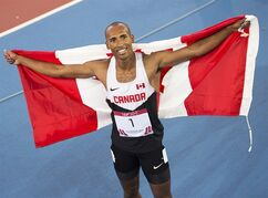 Canada's Damian Warner displays the flag after winning the gold medal in decathlon at Hampden Park at the Commonwealth Games in Glasgow, Scotland on Tuesday, July 29, 2014. THE CANADIAN PRESS/Andrew Vaughan