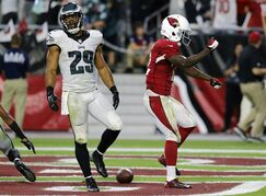 Arizona Cardinals wide receiver John Brown (12) celebrates his touchdown as Philadelphia Eagles strong safety Nate Allen (29) walks away during the second half of an NFL football game, Sunday, Oct. 26, 2014, in Glendale, Ariz. (AP Photo/Rick Scuteri)