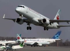 An Air Canada jet takes off from Halifax Stanfield International Airport in Enfield, N.S. Air Canada has announced it is changing its policy on the number of people required in the cockpit of its aircraft, a move prompted by the Germanwings plane crash in France.