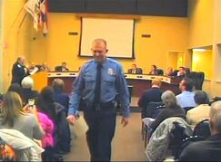 FILE - In this Feb. 11, 2014 file image from video provided by the City of Ferguson, Mo., officer Darren Wilson attends a city council meeting in Ferguson. Police identified Wilson, 28, as the police officer who shot 18-year-old Michael Brown on Aug. 9, 2014 in Ferguson, Mo. (AP Photo/City of Ferguson, File)