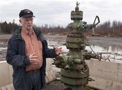 Ken Summers stands next to a wellhead for an exploratory natural gas well near his home not far from Noel, N.S. on Dec. 6. Summers is concerned about the hydraulic fracturing used in the resource extraction process and worries about the potential impacts on drinking water supplies. The head of a panel reviewing the potential for hydraulic fracturing in Nova Scotia says the province should not allow the industry to proceed until a broader public discussion is held and more research is completed. THE CANADIAN PRESS/Andrew Vaughan