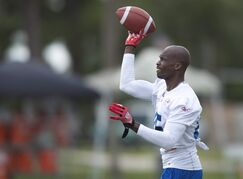 Former NFL wide receiver Chad Johnson throws the ball during minicamp practice with the Canadian Football League's Montreal Alouettes in Vero Beach, Fla., on Tuesday, April 15, 2014. Johnson will make his return to the gridiron in the Canadian Football League. THE CANADIAN PRESS/AP, Scripps Treasure Coast Newspapers, Sam Wolfe