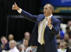 Indiana Pacers head coach Frank Vogel signals to his players in the first half of a preseason NBA basketball game against the Dallas Mavericks in Indianapolis, Saturday, Oct. 18, 2014. Indiana won 98-93. (AP Photo/R Brent Smith)