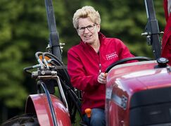 Ontario Premier Kathleen Wynne takes part in the 101st Annual International Plowing Match in Thornton, Ont., on Tuesday, September, 16 2014. THE CANADIAN PRESS/Nathan Denette