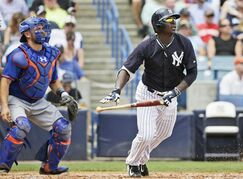 FILE - In this March 25, 2015, file photo, New York Mets catcher Travis d'Arnaud, left, and New York Yankees' Didi Gregorius watch Gregorius's third-inning, ground rule double in an exhibition baseball game in Tampa, Fla. (AP Photo/Kathy Willens, File)