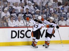 Anaheim Ducks Ryan Kesler (17) celebrates with Jakob Silfverberg (33) after scoring against the Winnipeg Jets during the third period of game three NHL playoff hockey action in Winnipeg, Monday, April 20, 2015. THE CANADIAN PRESS/Trevor Hagan