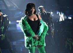 FILE - In this Sunday, March 29, 2015 file photo, Rihanna performs on stage at the iHeartRadio Music Awards at The Shrine Auditorium in Los Angeles. Madonna, Rihanna, Beyonce and Jay Z are among the A-List musicians who are co-owners of the streaming service Tidal. Kanye West, Daft Punk, Alicia Keys, Jack White and Nicki Minaj also announced that they are co-owners of the streaming service at an event Monday, March 30, 2015, in New York City. (AP Photo/iHeartRadio, John Shearer, File)