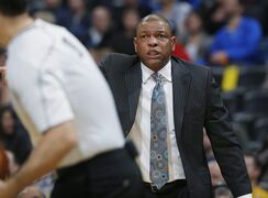 Los Angeles Clippers head coach Doc Rivers argues a call with referees first quarter of an NBA basketball game against the Denver Nuggets, Friday, Dec. 19, 2014, in Denver. (AP Photo/David Zalubowski)