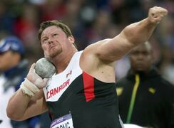 Dylan Armstrong of Canada throws in the finals of Shot Put competition at the Olympic Games in London on Friday August 3, 2012. After a long wait, Armstrong is finally going to receive an Olympic bronze medal for his third-place effort at the 2008 Beijing Games. Armstrong originally finished fourth but he moves up to third as a result of the lifetime ban given to Belarusian shot putter Andrei Mikhnevich. THE CANADIAN PRESS/Frank Gunn