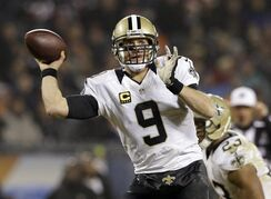 New Orleans Saints quarterback Drew Brees (9) throws a pass during the second half of an NFL football game against the Chicago Bears Monday, Dec. 15, 2014, in Chicago. (AP Photo/Nam Y. Huh)
