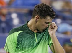 Dominic Thiem, of Austria, uses his shirt to wipe his face during a match against Tomas Berdych, of the Czech Republic, in the fourth round of the U.S. Open tennis tournament Tuesday, Sept. 2, 2014, in New York. (AP Photo/Darron Cummings)