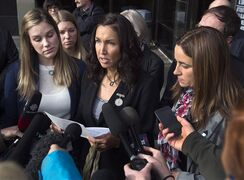 Angela Gevaudan is flanked by Rachael Ross, left, and Nadine Larche as they react to the sentencing of Justin Bourque, who killed their husbands, three RCMP officers, in June. Bourque was sentenced in Moncton, N.B. on Friday, October 31, 2014 and must serve 75 years in prison before he can apply for parole. THE CANADIAN PRESS/Andrew Vaughan