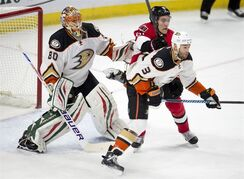 Ottawa Senators right wing Mark Stone clears Anaheim Ducks defenseman Clayton Stoner from in front of goalie Ilya Bryzgalov before scoring during first period NHL action Friday December 19, 2014 in Ottawa. THE CANADIAN PRESS/Adrian Wyld