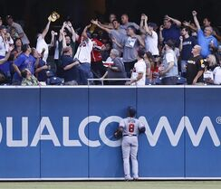 Atlanta Braves left fielder Justin Upton watches as a two-run home run by San Diego Padres' Tommy Medica lands in the stands during the first inning of a baseball game Friday, Aug. 1, 2014, in San Diego. (AP Photo/Don Boomer)