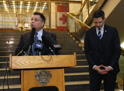 Geoff Patton (left) and Mayor Brian Bowman hold a news conference at city hall on Wednesday.