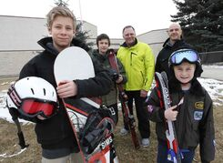 Snowboarder Jason Reid (from left), Andrew Petterson, teacher Doug Coates, Louis Riel School Division healthy living co-ordinator Grant McManes and skier Nolan St. George at Darwin School.