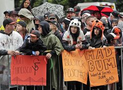 San Francisco Giants baseball fans wait in the rain for the start of the victory parade for the 2014 World Series Champion San Francisco Giants on Friday, Oct. 31, 2014 in San Francisco. (AP Photo/Marcio Jose Sanchez)