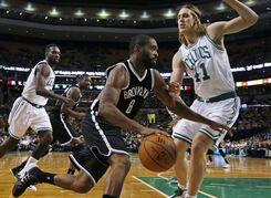 Brooklyn Nets guard Alan Anderson (6) drives the baseline against Boston Celtics center Kelly Olynyk (41) in the first quarter of a preseason NBA basketball game in Boston, Wednesday, Oct. 22, 2014. (AP Photo/Elise Amendola)