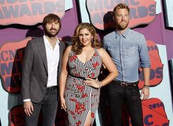 FILE - In this June 4, 2014 file photo, members of Lady Antebellum, from left, Dave Haywood, Hillary Scott and Charles Kelley arrive at the CMT Awards in Nashville,Tenn. The bands latest release,
