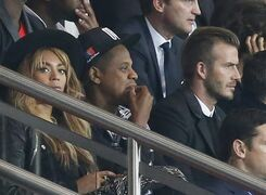 Former England and PSG soccer player David Beckham, right, Beyonce, left, and her husband Jay Z watch during the Champions League Group F soccer match between Paris Saint German and Barcelona at Parc des Princes stadium in Paris, France, Tuesday, Sept. 30, 2014. (AP Photo/Michel Euler)