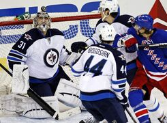 Jets goalie Ondrej Pavelec keeps his eye on the flying puck before making a save during second-period action at Madison Square Garden in New York Tuesday.