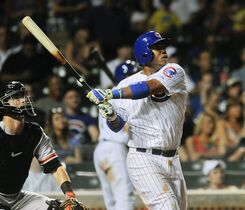 Chicago Cubs third baseman Luis Valbuena hits a solo home run in the eight inning of a baseball game against the San Francisco Giants on Wednesday, August 20, 2014, in Chicago. (AP Photo/Matt Marton)