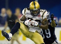 Winnipeg Blue Bombers defensive back Jonathan Hefney makes an interception against Toronto Argonauts wide receiver Spencer Watt during second-half action in Toronto on Saturday.