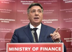 Ontario Finance Minister Charles Sousa speaks to the media prior to a pre-budget consultation session in Toronto on Friday, January 23, 2015. Ontario's finance minister says the province's deficit is $10.9 billion - lower than the previously projected $12.5 billion.THE CANADIAN PRESS/Frank Gunn