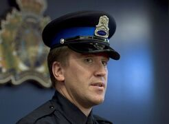 Const. Pierre Boudages, of the Halifax Regional Police, talks with reporters in Halifax on Friday, Sept. 20, 2013. Police have launched an investigation into a possible breach of a publication ban after a major news outlet in Halifax published the name of a teenage girl at the centre of a high-profile child pornography case.Const. Bourdages said Tuesday that they had received several reports from citizens complaining about the use of the girl's name, which is subject to a publication ban under the Criminal Code.THE CANADIAN PRESS/Andrew Vaughan