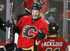 Calgary Flames' Lance Bouma celebrates his game-winning goal with teammates during third period NHL hockey action against the Edmonton Oilers in Calgary, Saturday, Jan. 31, 2015.THE CANADIAN PRESS/Jeff McIntosh