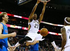 New Orleans Pelicans forward Anthony Davis (23) dunks the ball over Dallas Mavericks forward Dirk Nowitzki, left, during the second half of an NBA basketball game, Sunday, Jan. 25, 2015, in New Orleans. The Pelicans won 109-106. (AP Photo/Jonathan Bachman)