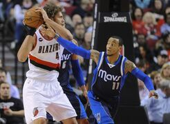 Dallas Mavericks' Monta Ellis (11) defends Portland Trail Blazers' Robin Lopez (42) during the first half of an NBA basketball game in Portland, Ore., Thursday, March 5, 2015. (AP Photo/Greg Wahl-Stephens)