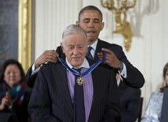 FILE - In this Nov. 20, 2013 file photo, President Barack Obama awards former Washington Post executive editor Ben Bradlee with the Presidential Medal of Freedom during a ceremony in the East Room of the White House in Washington. Bradlee died Tuesday, Oct. 21, 2014, according to the Washington Post. (AP Photo/ Evan Vucci, File)