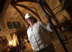 Rev. Cathy Campbell stands amid all the construction materials at what will become the new sanctuary at St. Matthew's Anglican Church.