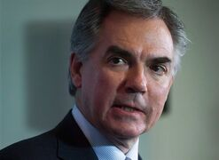 Alberta Premier Jim Prentice listens during a news conference in Vancouver, B.C., on November 3, 2014. Prentice has stirred up a whirlwind of anger by saying Albertans need to