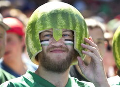A Saskatchewan Roughriders fan wears traditional watermelon head gear at the Toronto Argonauts CFL home opener against the Roughriders in Toronto on July 5.