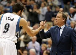 Minnesota Timberwolves' Ricky Rubio, left, of Spain, and head coach Flip Saunders celebrate after they defeated the Detroit Pistons 97-91 in a NBA basketball game, Thursday, Oct. 30, 2014, in Minneapolis. (AP Photo/Jim Mone)