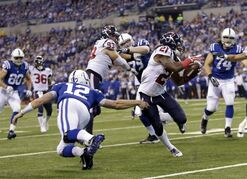 Houston Texans free safety Kendrick Lewis (21) gets past Indianapolis Colts quarterback Andrew Luck (12) on his way to the end zone for a touchdown on a interception during the first half of an NFL football game in Indianapolis, Sunday, Dec. 14, 2014. (AP Photo/AJ Mast)