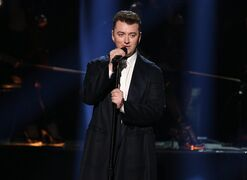 """FILE - In this Nov. 23, 2014, file photo, Sam Smith performs on stage at the 42nd annual American Music Awards at Nokia Theatre L.A. Live in Los Angeles. Tom Petty has earned a writing credit on Sam Smith's megahit """"Stay With Me"""" for its similarities to his song, """"I Won't Back Down."""" Smith's representative said Monday the publishers of Petty's 1989 hit contacted the publishers of Smith's song, which was one of last year's biggest hits. Smith and """"Stay With Me"""" writers James Napier and William Phillips say they agree their song is similar to Petty's song, written with Jeff Lynne. Petty's """"I Won't Back Down"""" peaked at No. 12 on Billboard's Hot 100 chart. A representative for Petty declined to comment. (Photo by Matt Sayles/Invision/AP, File)"""