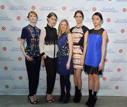 Designer Sarah Stevenson (centre) poses with models wearing designs from the Sarah Stevenson for Target collection in Toronto on Thursday, March 6, 2014. THE CANADIAN PRESS/ho-George Pimentel
