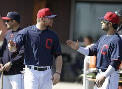 Cleveland Indians' Brandon Moss (44) talks with Nick Swisher, right, during spring training baseball practice Thursday, Feb. 26, 2015, in Goodyear, Ariz. (AP Photo/Darron Cummings)