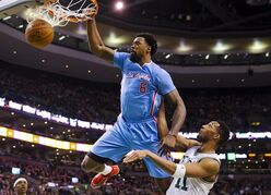 Los Angeles Clippers' DeAndre Jordan (6) dunks over Boston Celtics' Evan Turner during the first half of an NBA basketball game in Boston, Sunday, March 29, 2015. (AP Photo/Winslow Townson)
