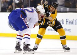 Boston Bruins' Gregory Campbell (11) fights Montreal Canadiens' Dale Weise during the first period of an NHL hockey game in Boston, Saturday, Nov. 22, 2014. (AP Photo/Winslow Townson)