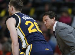 Utah Jazz head coach Quin Snyder, right, makes a point to guard Gordon Hayward as they talk during a timeout against the Denver Nuggets in the first quarter of an NBA basketball game Friday, March 27, 2015, in Denver. (AP Photo/David Zalubowski)
