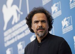 Director Alejandro Inarritu poses during a photo call for the movie The Birdman at the 71st edition of the Venice Film Festival in Venice, Italy, Wednesday, Aug. 27, 2014. THE CANADIAN PRESS/ AP/Andrew Medichini
